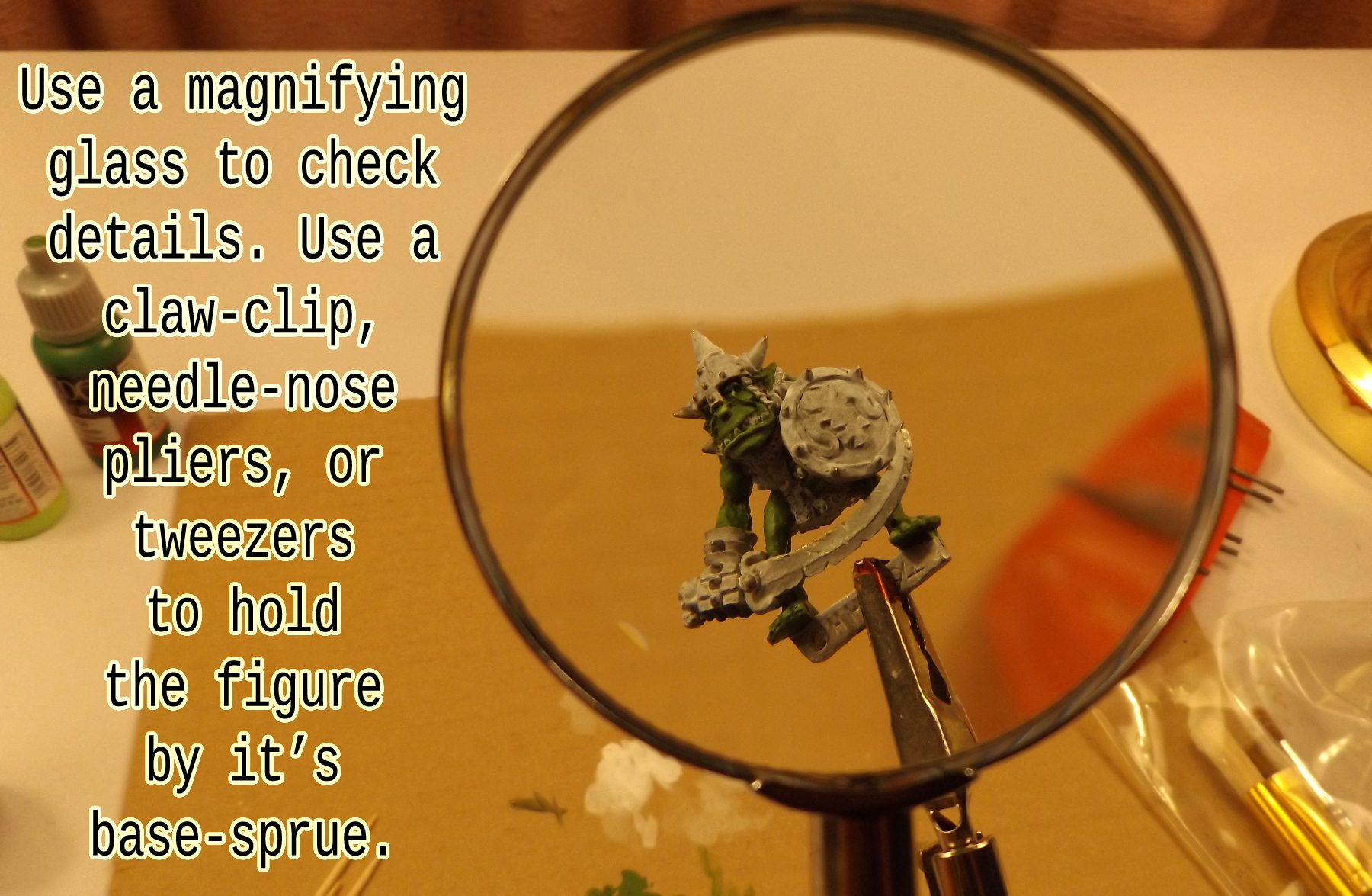 Use a magnifying glass to aid your eyes. Hold the figure with tools by the base-sprue.