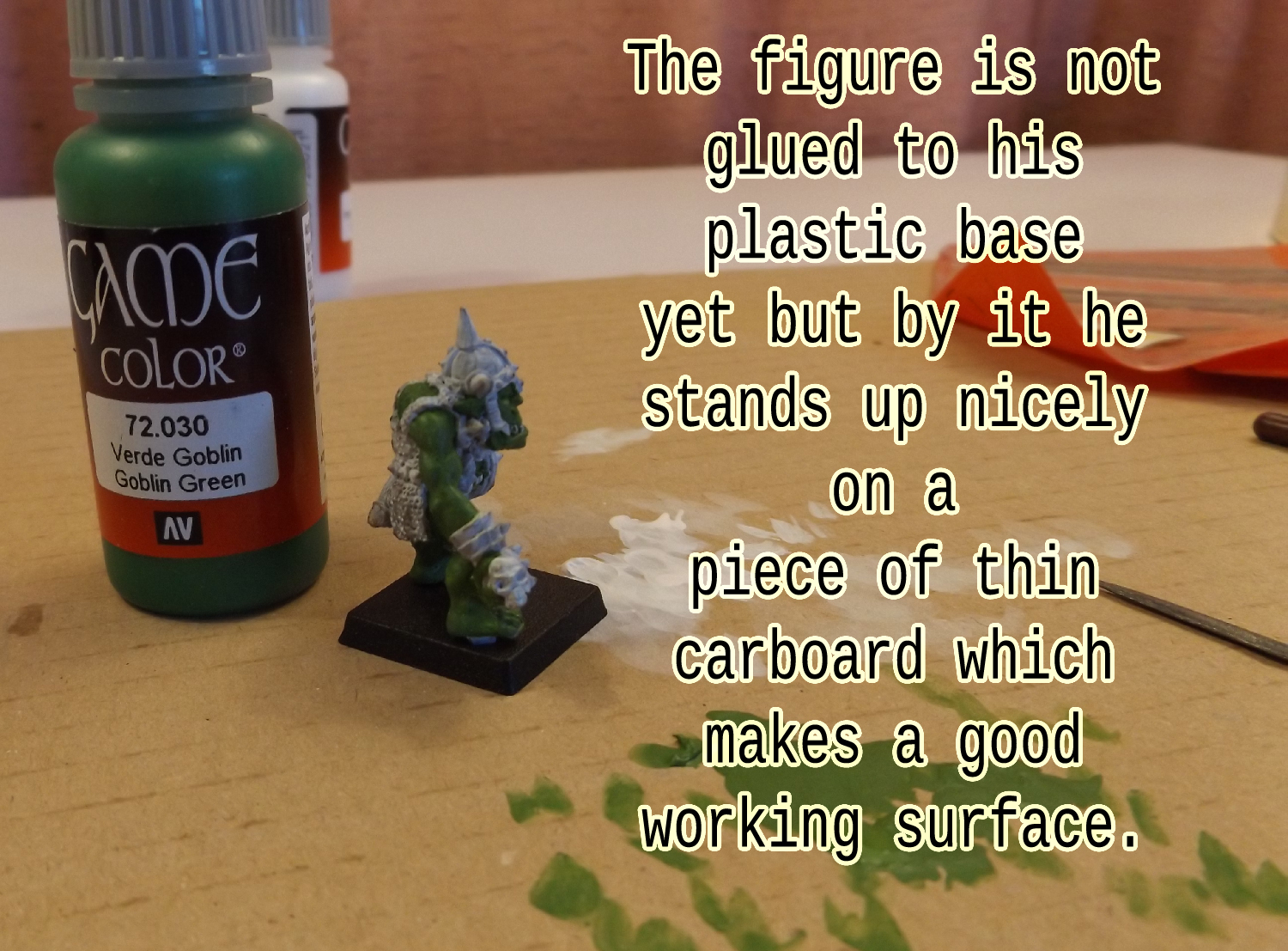 Don't glue your figure to its base yet. But use the base to stand him up if you can.